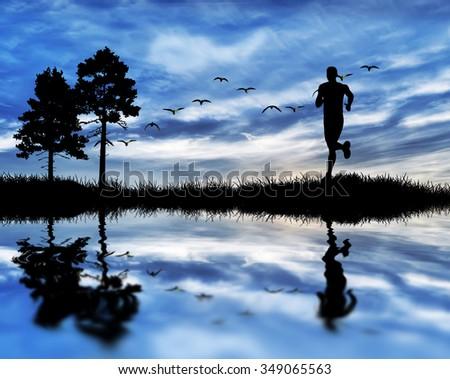 man running across the field - stock photo