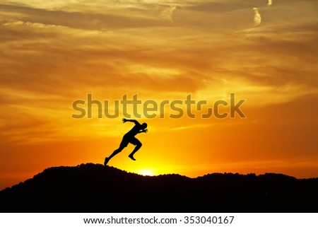 man running down the mountain - stock photo