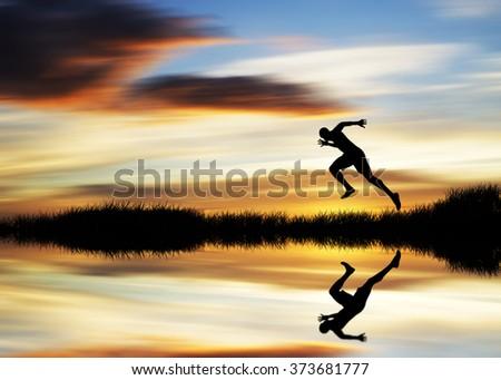 man running down the mountain  - stock photo