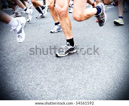 Man running in city marathon, motion blur - stock photo