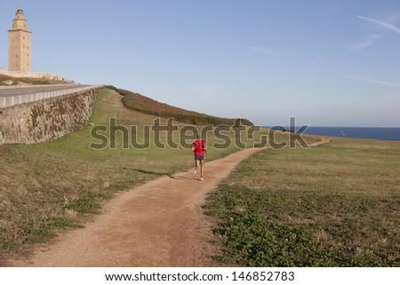 man running in the field - stock photo
