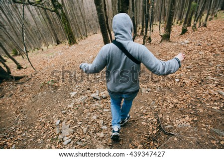 man running in the forest - stock photo