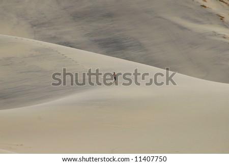 Man Running On Death Valley Sand Dune - stock photo