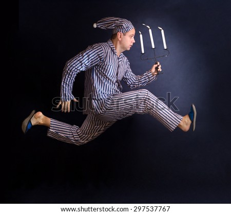 man running with a candlestick - stock photo