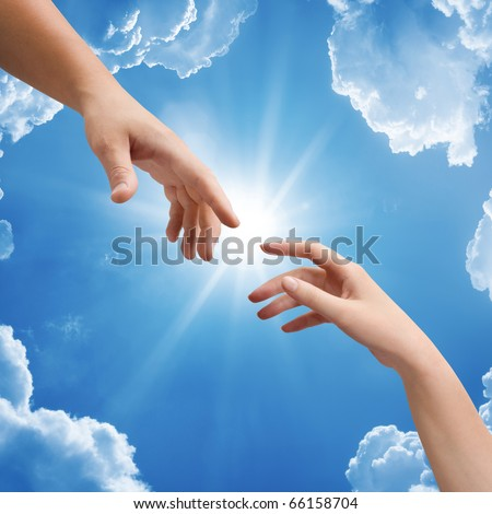 Man's and woman hand against the sky - stock photo
