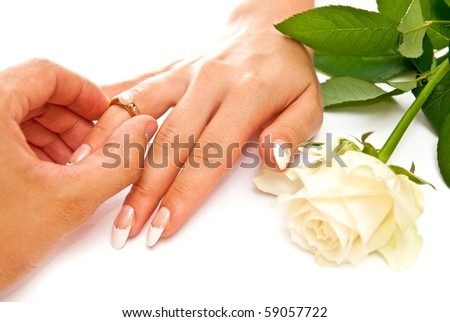 Man's and woman's hands with golden ring - stock photo