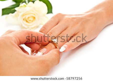 Man's and woman's hands with golden ring. White background - stock photo