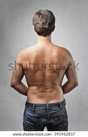 Man's back - stock photo
