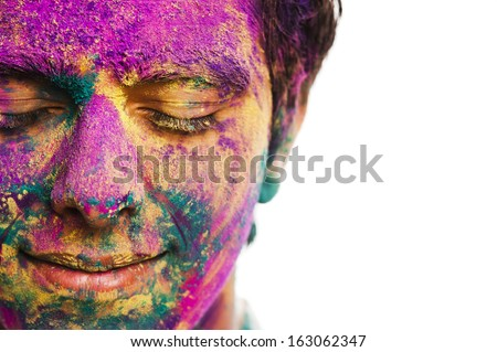 Man's face covered with powder paint during Holi festival - stock photo