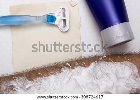 Man's hand before waxing shaving machine tool. - stock photo