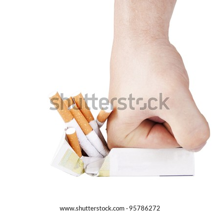 Man's hand crushing cigarettes on white background - stock photo