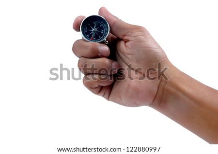 man's hand holding a compass isolated on white backgrund - stock photo