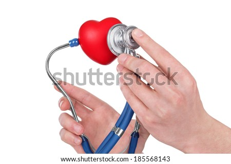 Man's hand holding a red heart and stethoscope - stock photo