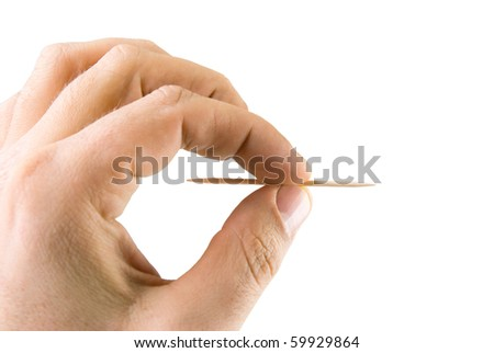man's hand holding a toothpick. Isolated on white - stock photo