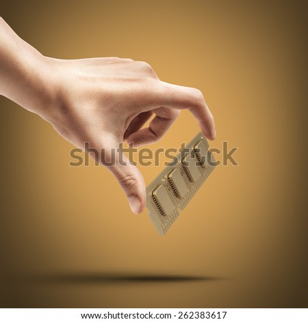 Man's hand holding Computer RAM Memory Card 64gb High resolution  - stock photo