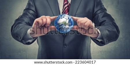 """Man's hand holding Earth (CONCEPT) """"Elements of this image furnished by NASA""""  High resolution  - stock photo"""