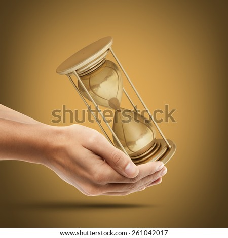 Man's hand holding golden hourglass sand clock. High resolution 3D collection of gold objects - stock photo