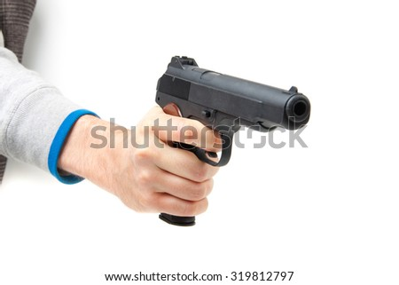 Man's hand holding gun, isolated on white background. - stock photo