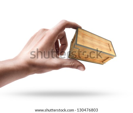 Man's hand holding wooden box isolated on white background - stock photo