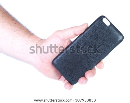 Man`s hand holds black iphone battery case isolated - stock photo