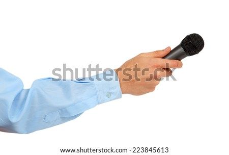 Man's hand in a blue shirt holding a microphone isolated on white background - stock photo