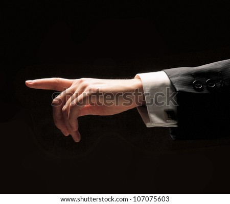Man's hand isolated on black background - stock photo