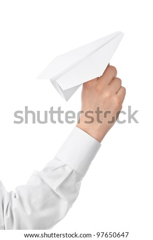 Man's hand launching white paper airplane isolated on white background. - stock photo