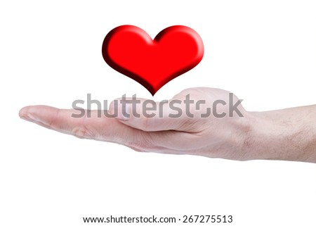 man's hand over her red heart - stock photo