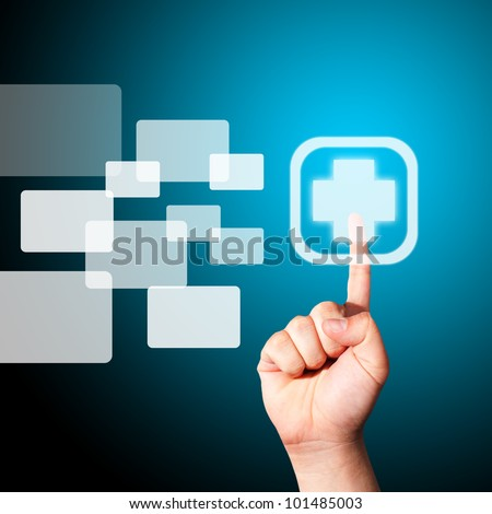 Man's Hand pushing on the medical sign on touch screen monitor - stock photo