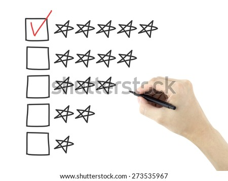 man's hand putting check mark with pen on five star rating - stock photo
