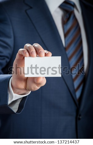 Man's hand showing business card - closeup shot - stock photo