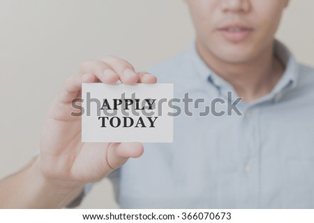 Man's hand showing NEW JOB text on the card business card - closeup shot on white background. - stock photo