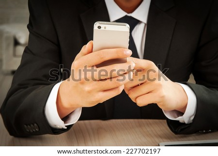Man's hand using a mobile phone - stock photo