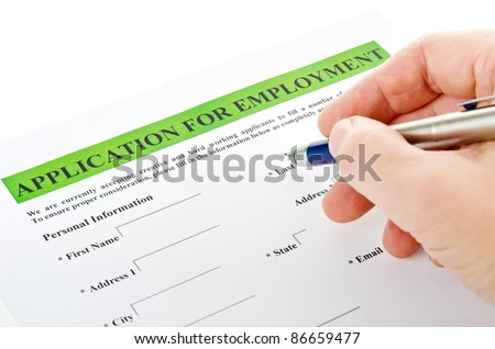 "man's hand with a fountain pen over blank ""application for employment"" - stock photo"
