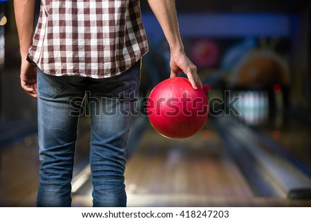 Man's hand with ball in bowling - stock photo