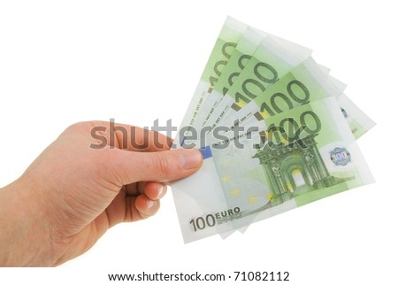 Man's hand with the bills of one hundred euros - stock photo