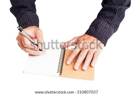 man's hand writing on a book - stock photo