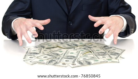 man's hands above the heap of dollars - stock photo