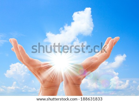 Man's hands reach for sky. Prayer at dawn - stock photo