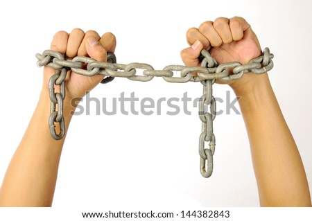 Man's hands tied with chains isolated over white background - stock photo