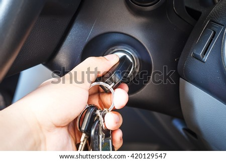 Man's hands to take the keys to start the engine car - stock photo