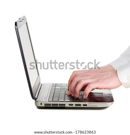 Man's hands typing on laptop keyboard isolated on white background - stock photo