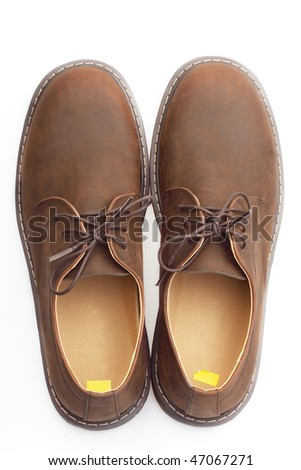 Man's leather brown boots - stock photo