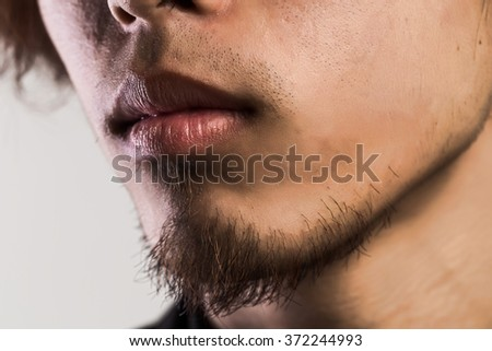 Man's mouth and chin close up - stock photo