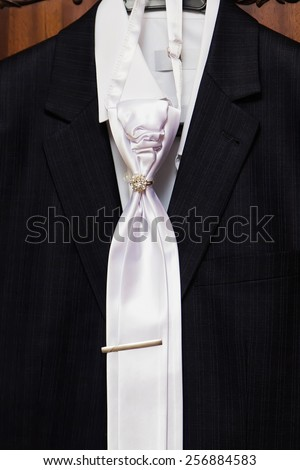 Man's style, dressing, black suit, shirt, white tie - stock photo