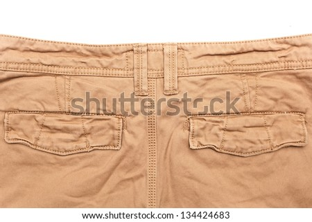 Man's trousers on white background showing rear pockets - stock photo
