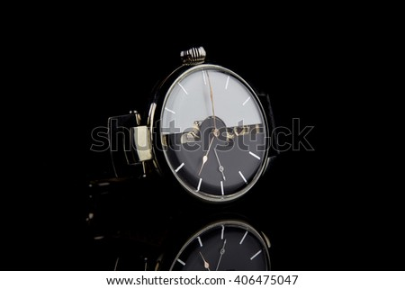 Man's watch on black background. Luxury goods. Black&White dial - stock photo