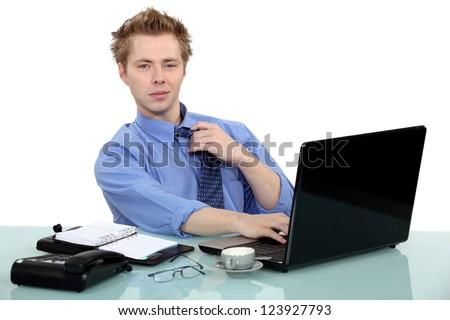 Man sat at desk - stock photo