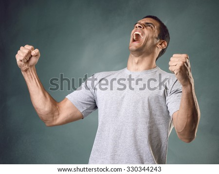 Man screaming at the sky - stock photo
