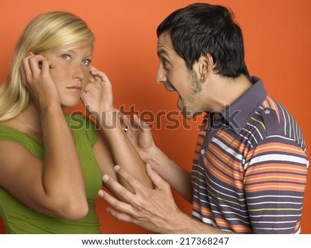Man screaming at woman - stock photo